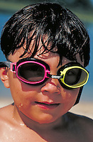 Little boy wearing swim goggles. Boy at the beach.