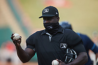 Home plate umpire James Jean during the minor league baseball game between the Wilmington Blue Rocks and Greensboro Grasshoppers at First National Bank Field on May 25, 2021 in Greensboro, North Carolina. (Brian Westerholt/Four Seam Images)