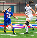 WOODBURY, CT-111120JS14 —Nonnewaug's Gianna Lodice (33) pushes the ball past Wolcott Tech's Julianna Minard (15) during their game Wednesday at Nonnewaug High School. <br /> Jim Shannon Republican-American