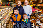 Breda, Adam and Daniel Furlong with James Brosnan at the Garveys Supervalu Castleisland's Food Fair on Tuesday.