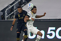 LOS ANGELES, CA - SEPTEMBER 13: Jeremy Ebobisse #17 of the Portland Timbers leaps high for a ball during a game between Portland Timbers and Los Angeles FC at Banc of California stadium on September 13, 2020 in Los Angeles, California.
