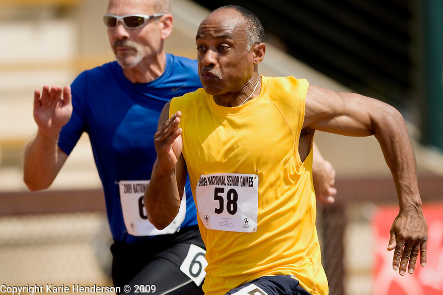 Letcher Pickens, right, 51, MO, races in the men's 50-54, 100 meter dash against Robert Slider, left, 51, KY, during the Senior Games 2009, at Stanford University's Cobb Track and Angell Field, in Palo Alto, Calif., on Sunday, August 09 2009.