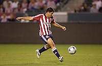 Chivas USA forward Alecko Eskandarian (7) takes a shot on goal during a MLS match. The San Jose Earthquakes and Chivas USA played to 0-0 draw at Home Depot Center stadium on Saturday, August 23, 2008.