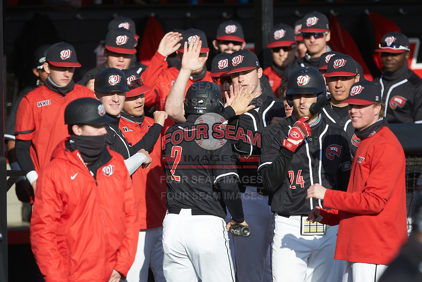 Matthew Meyer (2) of the Western Kentucky Hilltoppers is congratulated by his teammates after scoring a run in the first inning of the game against the Valparaiso Crusaders at Nick Denes Field on March 19, 2021 in Bowling Green, Kentucky. (Brian Westerholt/Four Seam Images)