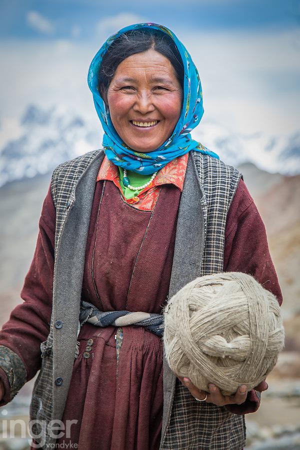 Dolma spinning wool in Ulley Village, Ladakh