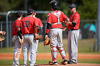 Ball State Cardinals head coach Rich Maloney (right) makes a pitching change during a game against the Mount St. Mary's Mountaineers on March 9, 2019 at North Charlotte Regional Park in Port Charlotte, Florida.  Ball State defeated Mount St. Mary's 12-9.  (Mike Janes/Four Seam Images)