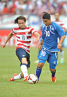 Mix Diskerud (8) of the USMNT goes against Kevin Santamaria (10) of El Salvador.  The USMNT defeated El Salvador 5-1 at the quaterfinal game of the Concacaf Gold Cup, M&T Stadium, Sunday July 21 , 2013.