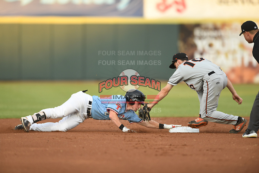 Jax Biggers (2) of the Hickory Crawdads holds on after sliding past second base as Adam Hall (10) of the Delmarva Shorebirds attempts to apply the tag during game one of the Northern Division, South Atlantic League Playoffs at L.P. Frans Stadium on September 4, 2019 in Hickory, North Carolina. The Crawdads defeated the Shorebirds 4-3 to take a 1-0 lead in the series. (Tracy Proffitt/Four Seam Images)