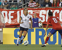 USWNT defender Kristie Mewis (8) dribbles. In an international friendly, the U.S. Women's National Team (USWNT) (white/blue) defeated Korea Republic (South Korea) (red/blue), 4-1, at Gillette Stadium on June 15, 2013.