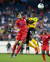 NASHVILLE, TN - JULY 4: Christian Pulisic #10 and Andre Lewis #4 go up for a header during a game between Jamaica and USMNT at Nissan Stadium on July 4, 2019 in Nashville, Tennessee.
