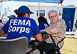 MEXICO BEACH, FL 0CT 18: Wanda Walker talks with a  FEMA  representative outside City Hall in Mexico Beach, Florida after Hurricane Michael October 18, 2018.