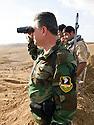Iraq 2014 <br /> Outpost of peshmergas,on the front line district of Mahmur, Kader Hassan, former politician, looking at Daesh outpost  <br /> Irak 2014 <br /> Avant-poste de peshmergas, sur la ligne de front, district de Mahmur, Kader Hassan, ancien parlementaire regardant les avant-postes de Daesh