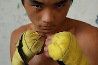 Li Le Fa, 15,  in Huili Middle School in Sichuan Province, China. The group of young boxers are hoping to make it to become some of China's first professional boxers. ..PHOTO BY SINOPIX