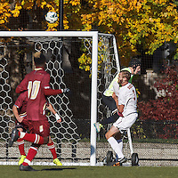 Boston College goalkeeper Alex Kapp (1) takes out Virginia Tech defender Drew Ranahan (3) after Drew Ranahan passed, for a Virginia Tech penalty kick.Boston College (maroon) defeated Virginia Tech (Virginia Polytechnic Institute and State University) (white), 3-1, at Newton Campus Field, on November 3, 2013.