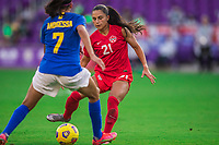 ORLANDO, FL - FEBRUARY 24: Jordyn Listro #21 of the CANWNT battles for the ball during a game between Brazil and Canada at Exploria Stadium on February 24, 2021 in Orlando, Florida.