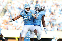 CHAPEL HILL, NC - SEPTEMBER 28: Chazz Surratt #21 and Jonathan Smith #7  of the University of North Carolina celebrate on the sideline during a game between Clemson University and University of North Carolina at Kenan Memorial Stadium on September 28, 2019 in Chapel Hill, North Carolina.