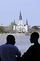 Ferry passengers enjoy the view of the New Orleans Riverfront skyline from the Algiers ferry that crosses the Mississippi River, Saturday, March 26, 2005.<br /> (Cheryl Gerber Photo)