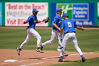 Memphis Tigers James Muse (15) high fives Ian Bibiloni (3) jogging off the field with Zach Wilson (6) during a game against the East Carolina Pirates on May 25, 2021 at BayCare Ballpark in Clearwater, Florida.  (Mike Janes/Four Seam Images)