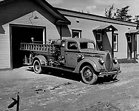 A modern high-powered pumper; a water system; and a prize- winning crew of firefighters (volunteer) give Val d'Or excellent fire protection.<br /> <br /> 1938<br /> <br /> PHOTO : Toronto Star Archives - AQP