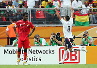 Clint Dempsey (8) of the USA passes Derek Boeteng (9) of Ghana after scoring USA goal. Ghana defeated the USA 2-1 in their FIFA World Cup Group E match at Franken-Stadion, Nuremberg, Germany, June 22, 2006.