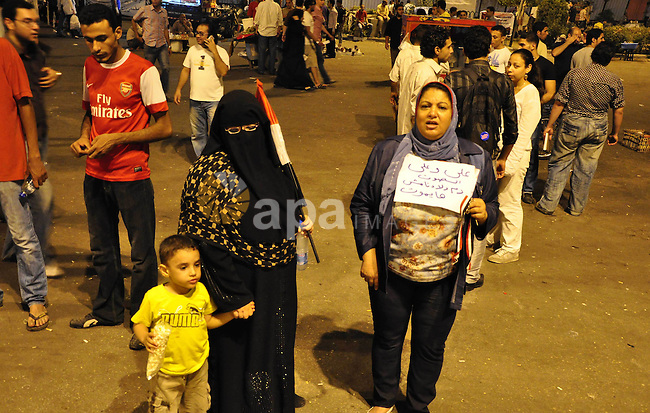Hundreds of demonstrators gather as they spend their second night in Cairo's Tahrir Square, on July 10, 2011, at the landmark square vowing to keep up their sit-in despite a series of concessions by the Egyptian prime minister. Photo by Ahmed Asad