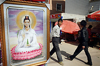 CHINA. Market scene in Zijun village in Kunming, home of the Samatao minority. 2010