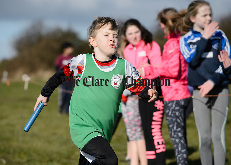 Michael O Sullivan of Kilrush gives of his best in an U-10 relay at the Clare Community Games Cross Country finals in Kilnaboy. Photograph by John Kelly.