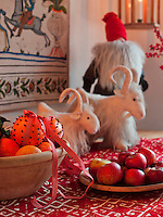 Clove scented oranges provide an aromatic and festive decoration on this table