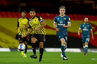 26th December 2020; Vicarage Road, Watford, Hertfordshire, England; English Football League Championship Football, Watford versus Norwich City; Troy Deeney of Watford passes the ball away from Oliver Skipp of Norwich City