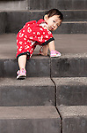 Climber 02 - Young Chinese girl climbing the concrete steps of the School Of The Arts (SOTA), Singapore