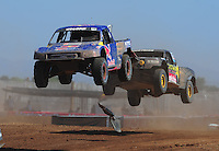 Apr 16, 2011; Surprise, AZ USA; LOORRS driver Ricky Johnson (48) leads Kyle Leduc (99) during round 3 at Speedworld Off Road Park. Mandatory Credit: Mark J. Rebilas-.