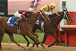HOT SPRINGS, AR - APRIL 9: Terra Promessa #2 with jockey Ricardo Santana, Jr., holding off Taxable #1 with jockey Joseph Rocco, Jr. while crossing the finish line in the Fantasy Stakes at Oaklawn Park on April 9, 2016 in Hot Springs, Arkansas. (Photo by Justin Manning/Elipse Sportwire/Getty Images)