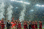 Players of Bayern Munich celebrates with the trophy after winning a friendly match against VfL Wolfsburg as part of the Audi Football Summit 2012 on July 26, 2012 at the Guangdong Olympic Sports Center in Guangzhou, China. Photo by Victor Fraile / The Power of Sport Images