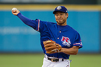 Round Rock Express second baseman Kensuke Tanaka (8) makes a throw to first base during the Pacific Coast League baseball game against the Sacramento River Cats on June 19, 2014 at the Dell Diamond in Round Rock, Texas. The Express defeated the River Cats 7-1. (Andrew Woolley/Four Seam Images)