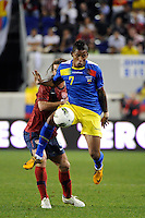 Michael Arroyo (7) of Ecuador plays the ball in front of Kyle Beckerman (6) of the United States. The men's national team of the United States (USA) was defeated by Ecuador (ECU) 1-0 during an international friendly at Red Bull Arena in Harrison, NJ, on October 11, 2011.