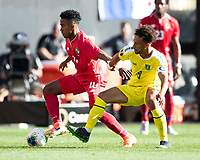 CLEVELAND, OH - JUNE 22: Edgar Barcenas #10 dribbles away from Samuel Cox #8 during a game between Panama and Guyana at FirstEnergy Stadium on June 22, 2019 in Cleveland, Ohio.