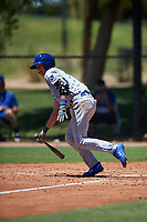 AZL Royals Bobby Witt Jr. (17) starts running towards first base during an Arizona League game against the AZL Dodgers Lasorda on July 4, 2019 at Camelback Ranch in Glendale, Arizona. The AZL Royals defeated the AZL Dodgers Lasorda 4-1. (Zachary Lucy/Four Seam Images)