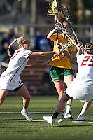 Boston College midfielder Kate McCarthy (20) and Boston College midfielder Rachel Igoe (25) combine to stifle University of Vermont midfielder Adison Rounds (23). Boston College defeated University of Vermont, 15-9, at Newton Campus Field, April 4, 2012.