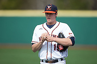Virginia Cavaliers starting pitcher Nathan Kirby (19) warms up in the outfield prior to the game against the Hartford Hawks at The Ripken Experience on February 27, 2015 in Myrtle Beach, South Carolina.  The Cavaliers defeated the Hawks 5-1.  (Brian Westerholt/Four Seam Images)