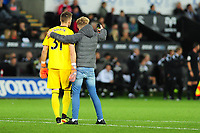 SWANSEA, WALES - AUGUST 28:A fan runs onto the pitch to take a selfie with Vicente Guaita of Crystal Palace during the Carabao Cup Second Round match between Swansea City and Crystal Palace at Liberty Stadium, in Swansea, Wales. August 28, 2018