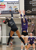 Trinity Hamilton (3) of Bentonville for the kill against Madeline Lafata (16) of Fayetteville on Thursday, Oct.  7, 2021, during play at Tiger Arena in Bentonville. Visit nwaonline.com/211008Daily/ for today's photo gallery.<br /> (Special to the NWA Democrat-Gazette/David Beach)