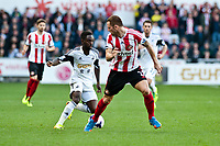 Saturday 19 October 2013 Pictured: Nathan Dyer tries to get the ball past Phill Bardsley of Sunderland<br /> Re: Barclays Premier League Swansea City vSunderland at the Liberty Stadium, Swansea, Wales