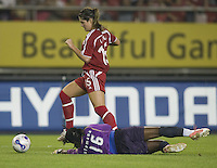 Canada foward (15) Kara Lang dribbles around Ghana goalkeeper (16) Memunatu Sulemana during their first round game at the 2007 FIFA Women's World Cup at Hangzhou Dragon Stadium in Hangzhou, China.  Canada defeated Ghana, 4-0.