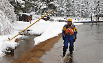 An estimated 500 participants jumped into Lake Tahoe as part of the 8th annual Polar Plunge to benefit Special Olympics at Zephyr Cove, Nev. , on Saturday, March 17, 2012. Tahoe Douglas Fire personnel were also on hand. .Photo by Cathleen Allison