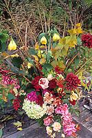 Autumn bouquet of flowers with roses, abutilon and grasses. Michael Bates design