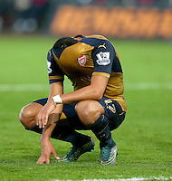 Despite being 3-0 up, Alexis Sanchez of Arsenal shows a look of frustration as he puts his shirt over his face during the Barclays Premier League match between Swansea City and Arsenal played at The Liberty Stadium, Swansea on October 31st 2015