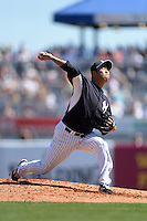 Pitcher Hiroki Kuroda (18) of the New York Yankees during a spring training game against the Philadelphia Phillies on March 1, 2014 at Steinbrenner Field in Tampa, Florida.  New York defeated Philadelphia 4-0.  (Mike Janes/Four Seam Images)
