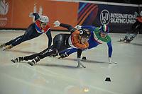 SPEEDSKATING: DORDRECHT: 05-03-2021, ISU World Short Track Speedskating Championships, Heats 500m Men, Dylan Hoogerwerf (NED), Luca Spechenhauser (ITA), ©photo Martin de Jong