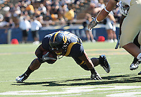 Isi Sofele is careful not to drop a knee to continue the play. The University of California Berkeley Golden Bears defeated the UC Davis Aggies 52-3 in their home opener at Memorial Stadium in Berkeley, California on September 4th, 2010.