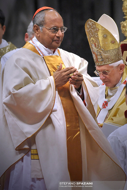 Pope Benedict XVI (L) gives his cardinal ring to Sri Lanka Albert Malcolm Ranjith Patabendige Don (R) during the Eucharistic celebration with the new cardinals on November 21, 2010 at St Peter's basilica at The Vatican. 24 Roman Catholic prelates joined the day before the Vatican's College of Cardinals, the elite body that advises the pontiff and elects his successor upon his death.